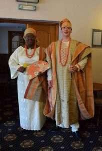 Olawumni and Matt in traditional Nigerian wedding dress