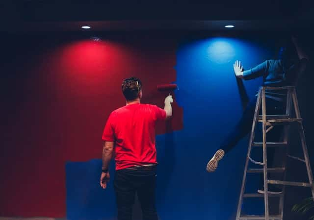 Making Progress with an image of Christian singles painting a room