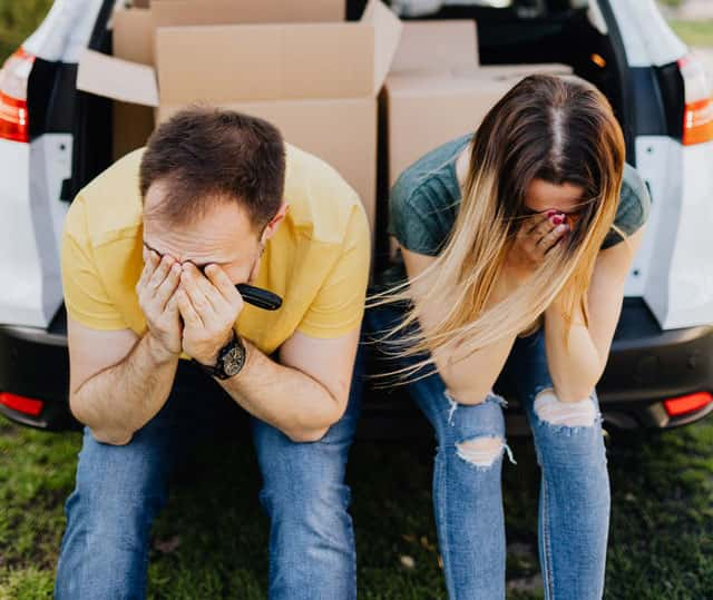 couple with their heads in their hands showing they are not ready for a relationship