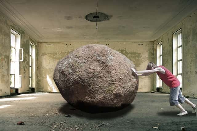 Man trying to push a rock showing the hard work of dating