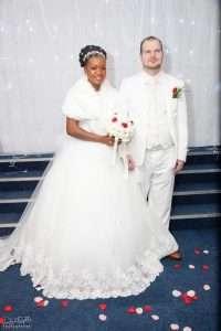 Joe & Evelyn sealing their pure Christian love posing at their wedding